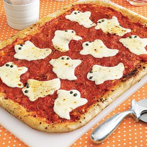 Spooky pizza with cheese ghosts